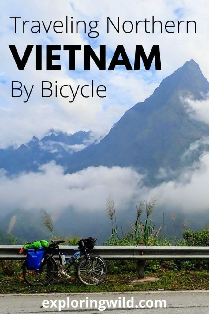 Picture of touring bicycle on road with mountains in background, with text: Traveling northern Vietnam by bicycle