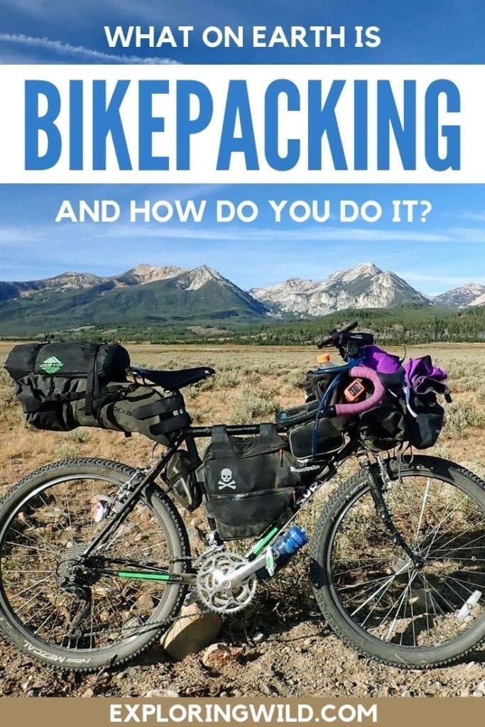 Picture of loaded bikepacking bike in front of mountains, with text overlay: What on earth is bikepacking and how do you do it?