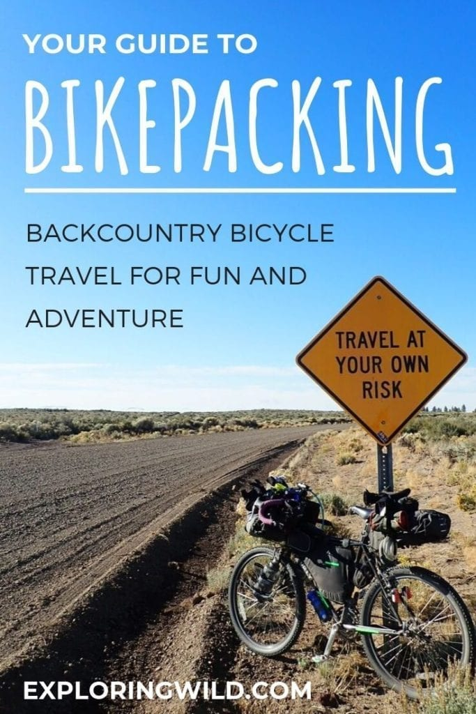 Picture of bicycle on gravel road with text overlay: Your guide to bikepacking: backcountry bicycle travel for fun and adventure