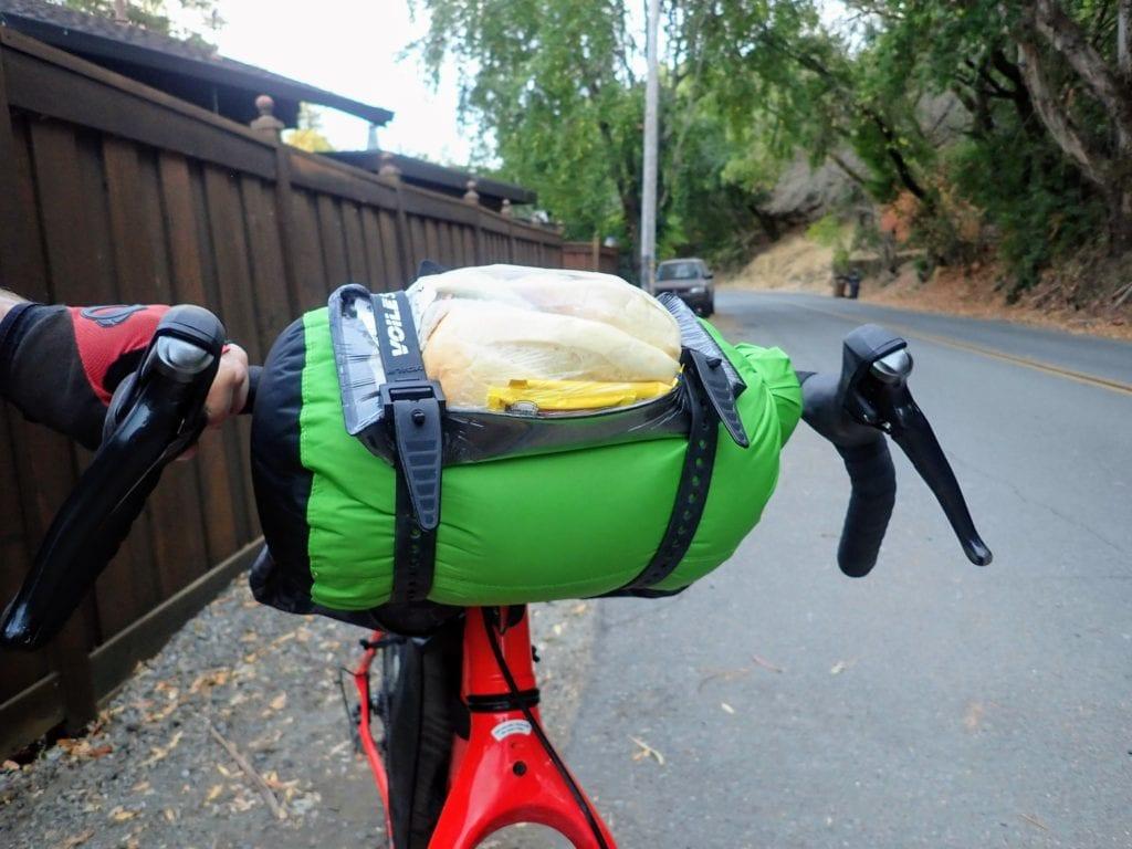 Budget bikepacking gear hack for carrying sleeping bag on handlebars