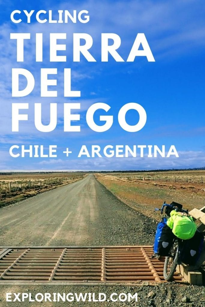 Picture of touring bike on cattle guard in gravel road in Argentina, with text: Cycling Tierra Del Fuego, Chile + Argentina