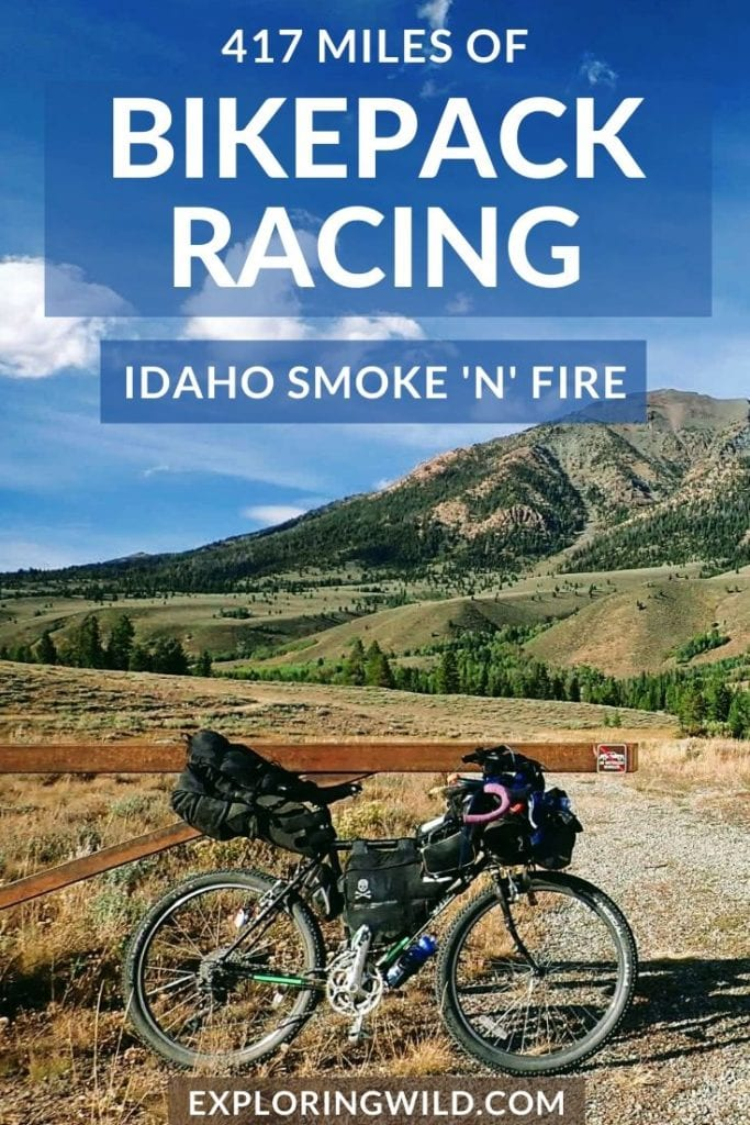 Picture of loaded bike in front of gravel road and mountains, with text: 417 miles of Bikepack Racing, Idaho Smoke 'n' Fire