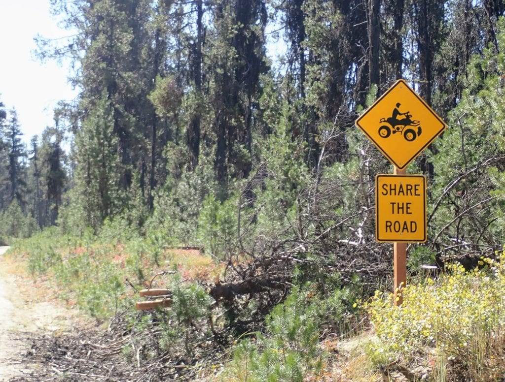 """Road sign saying """"Share the road"""" with picture of ATV"""