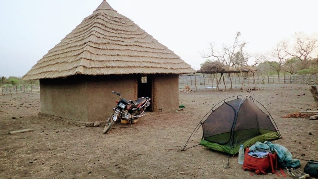 Tent besides hut in Guinean Highlands
