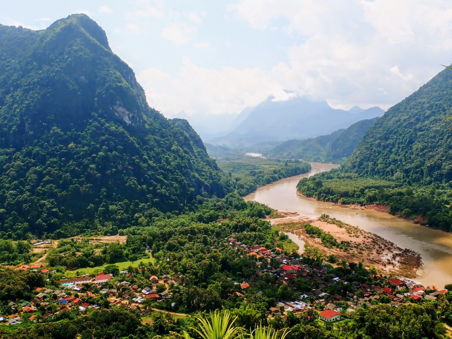 Laos village by river in mountains