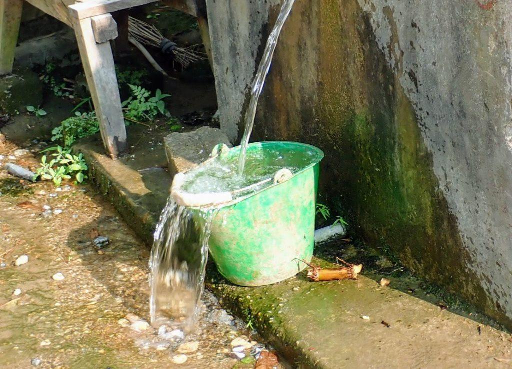 water bucket and spring in rural Vietnam