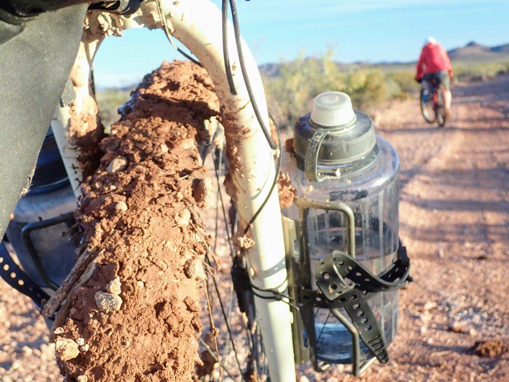 Fork mounted water bottles on bikepacking bike