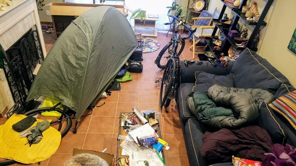 Living room full of outdoor gear
