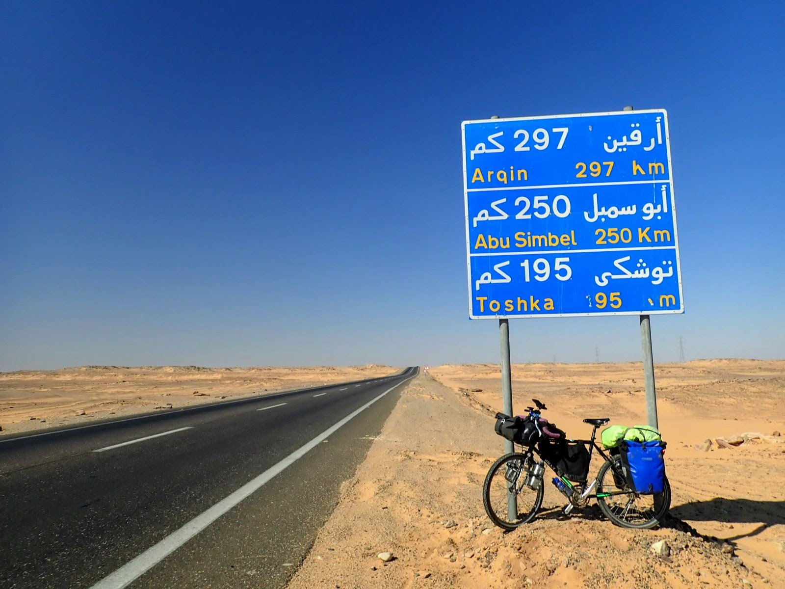 Bicycle and road sign in Egypt desert