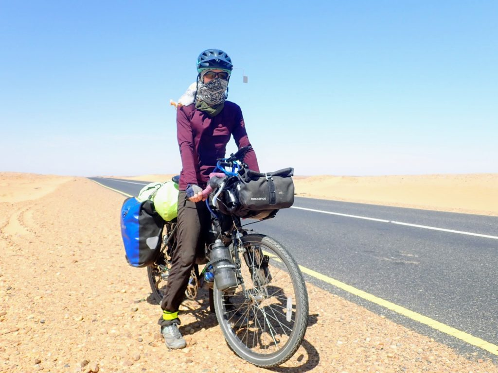 Solo female cyclist riding in Sudan
