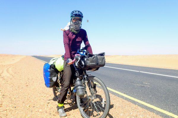 Solo female cyclist riding in Sudan