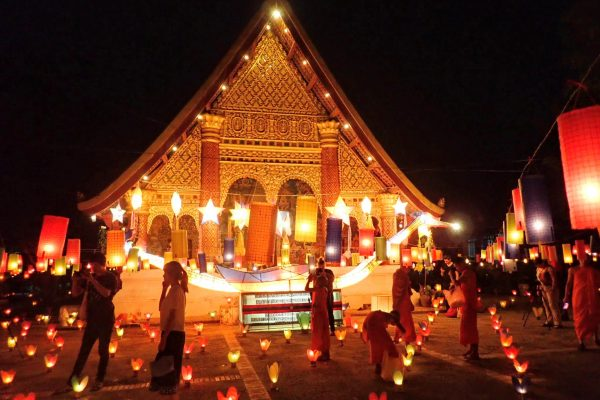 Beautifully lit temple during festival of lights in Luang Prabang
