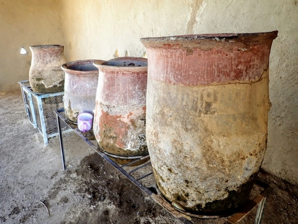 Clay water pots by the roadside, a common water source in Sudan