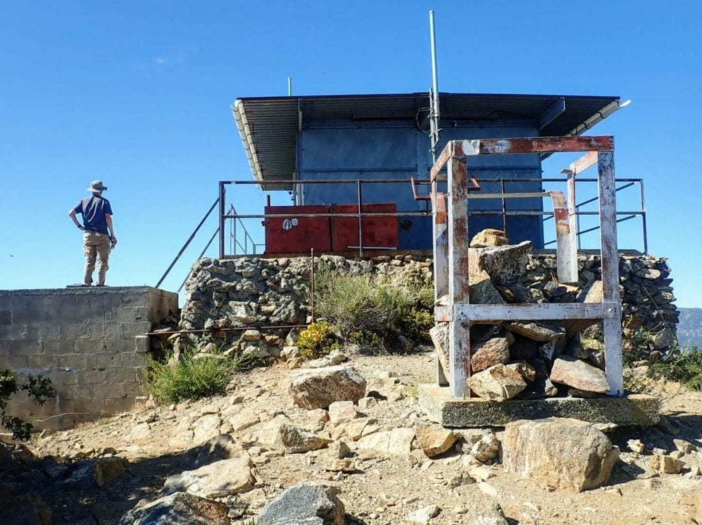 Fire lookout at summit of Cone Peak hike