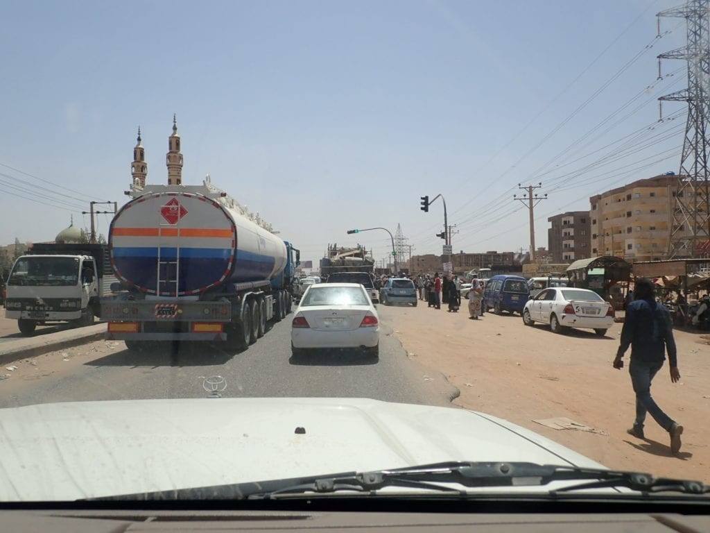 Chaotic traffic in Khartoum from car window