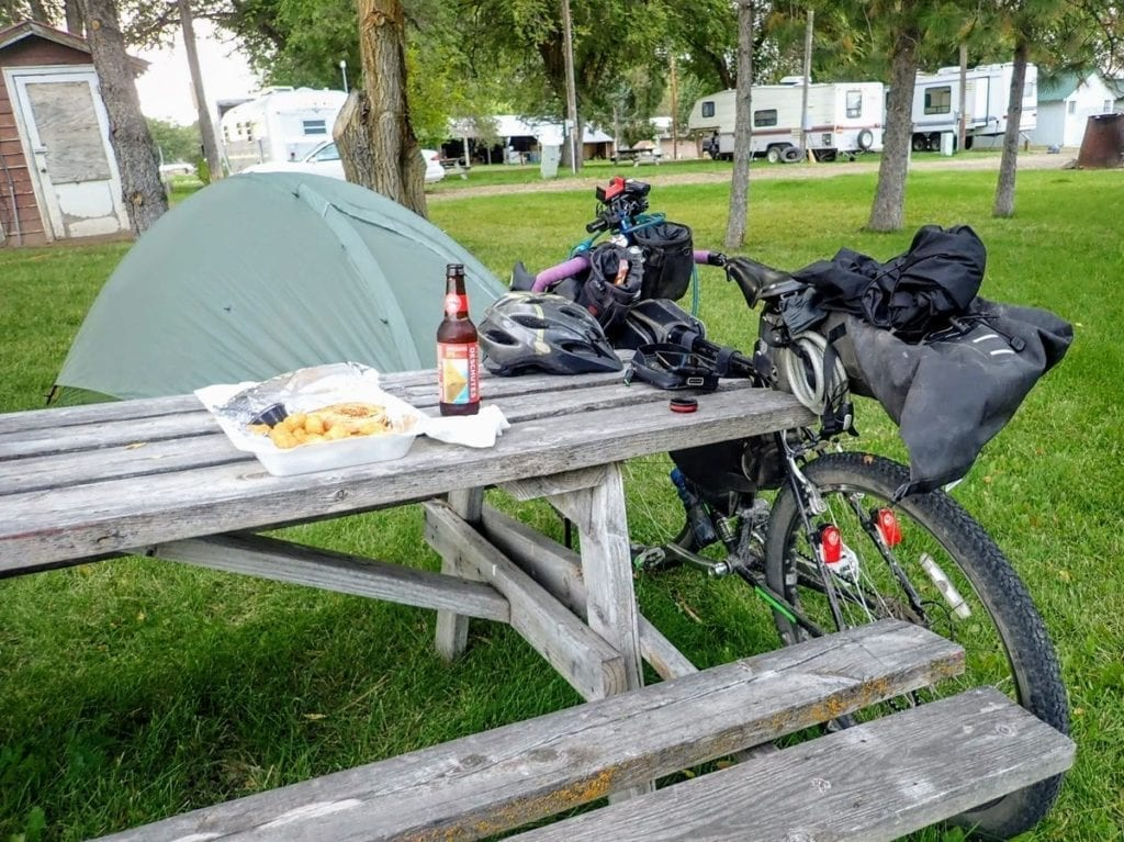 Picnic table with bike and dinner at RV park
