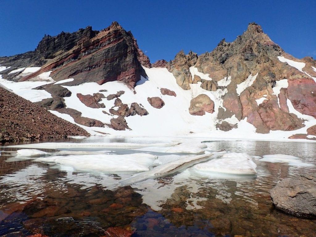 Alpine lake with floating ice