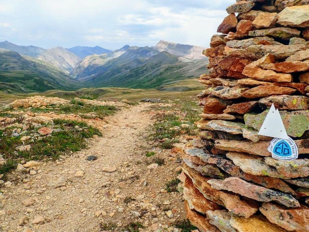Colorado Trail blaze on rock cairn marking the Colorado Trail in segment 23