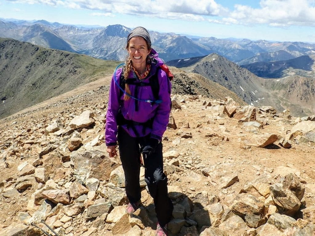 Hiker on summit of Mt. Elbert during side trip from Colorado Trail