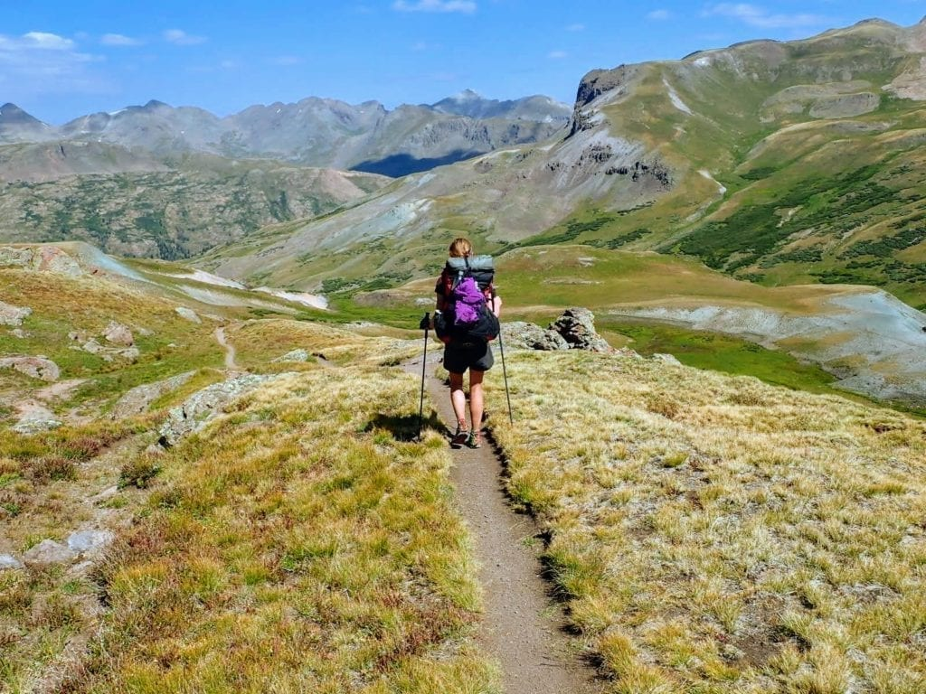 Hiker on smooth trail in the scenic San Juan mountains