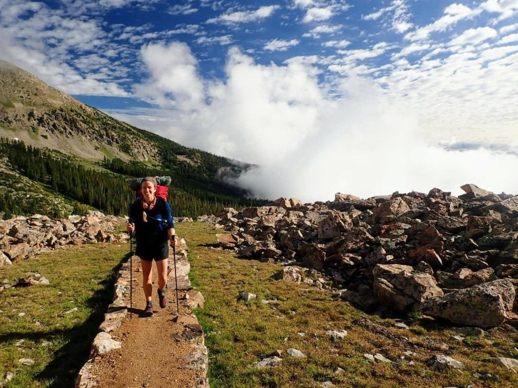 Woman hikes near Tenmile crest on Colorado Trail