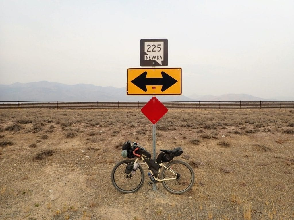 Bicycle leans against Nevada highway 225 road sign
