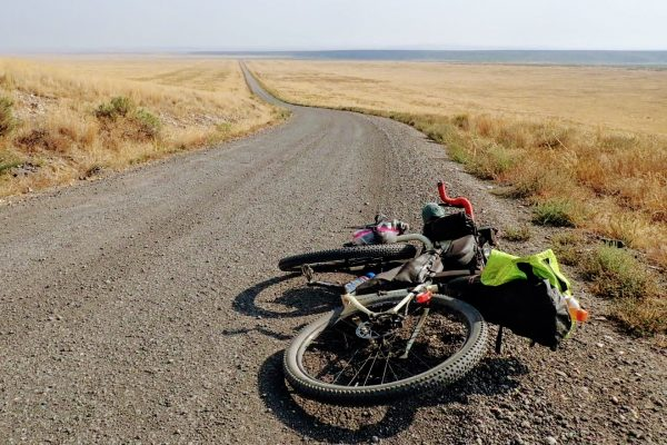 Bikepacking bicycle lying on gravel road in open plains