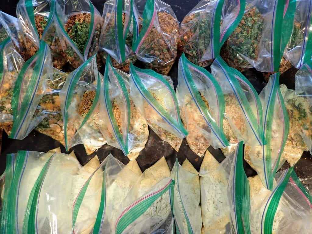 Preparing backpacking meals in many plastic bags