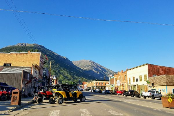 Main street in Silverton Colorado with mountain backdrop