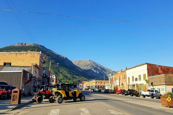 Main street in Silverton Colorado with mountain backdrop