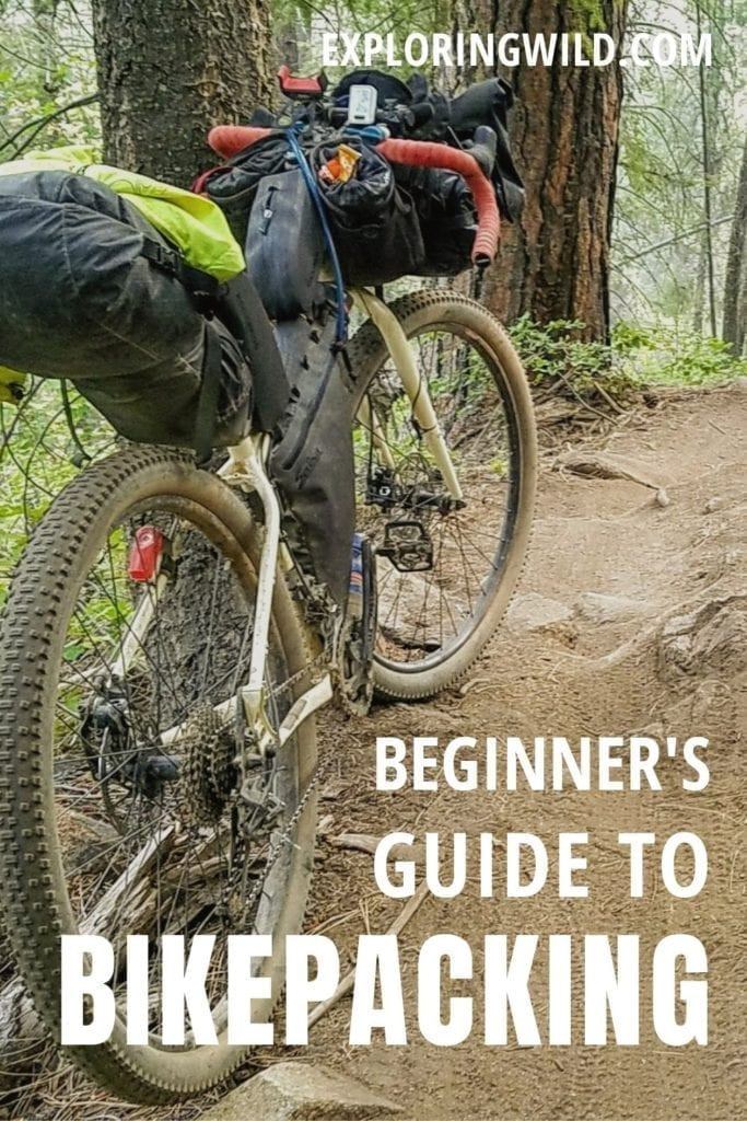 Picture of bike on forest trail with text: Beginner's Guide to Bikepacking