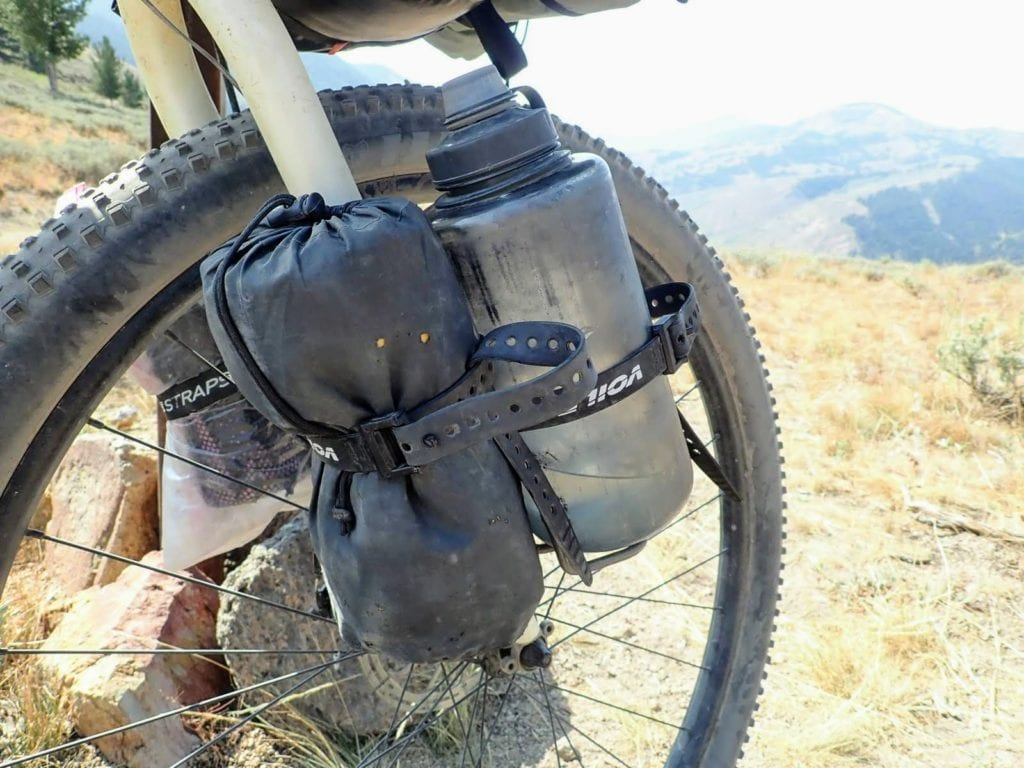 Bikepacking bike with water bottle mounted to front fork