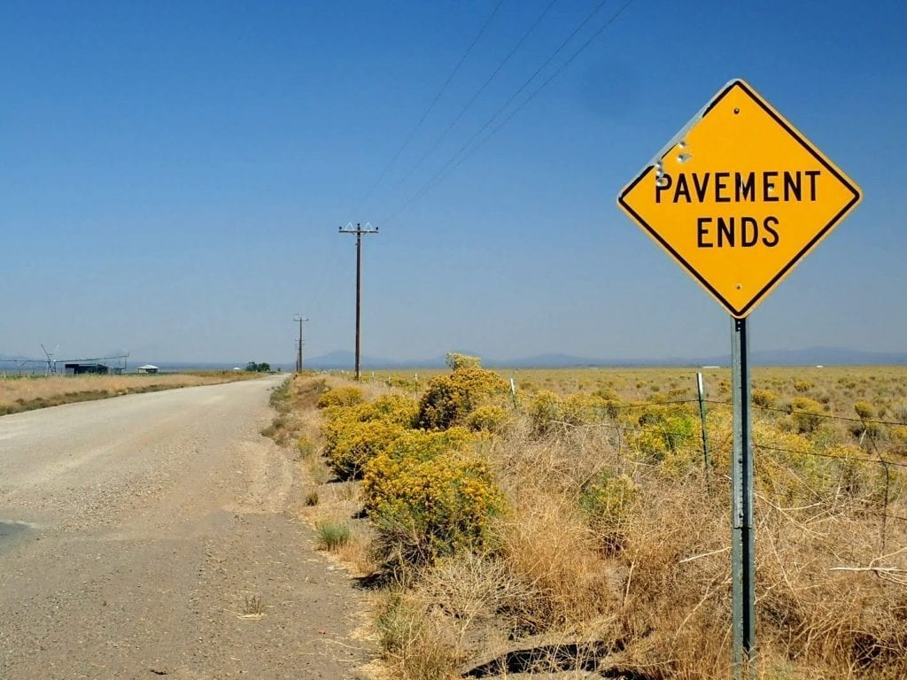 Pavement ends sign on gravel road through Oregon outback