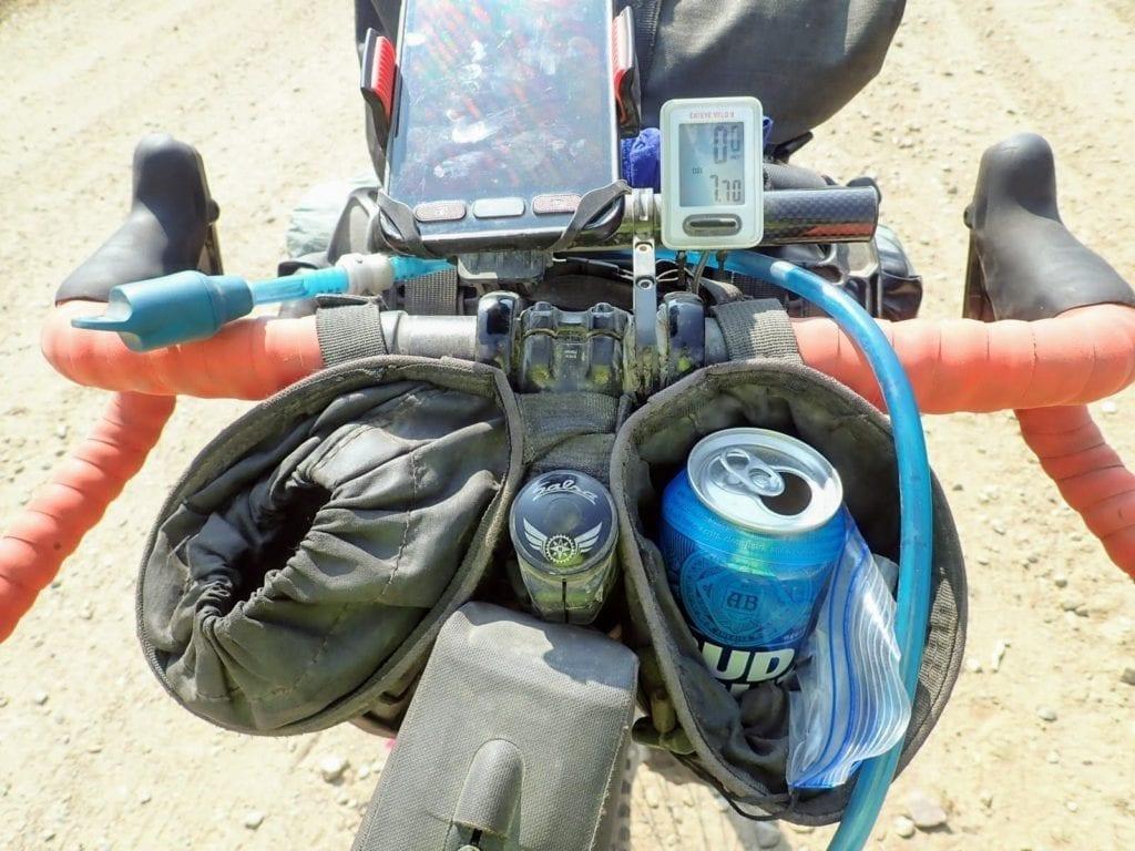 Bikepacking stem bags holding beer