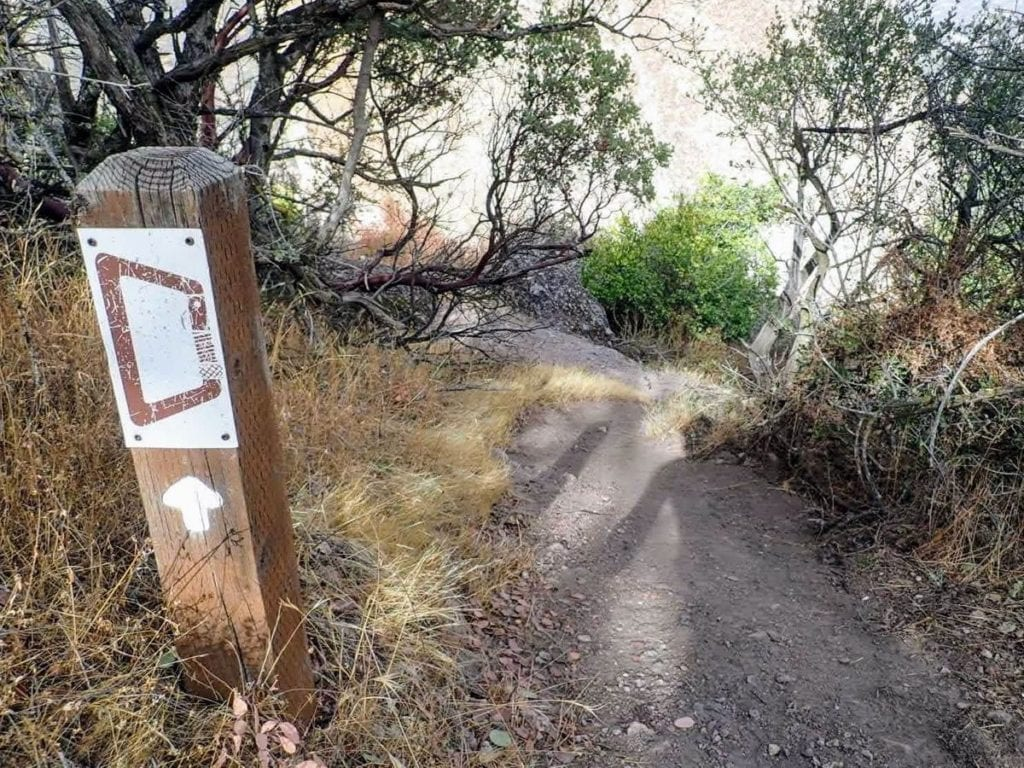 Picture of a carbiner on a trail sign