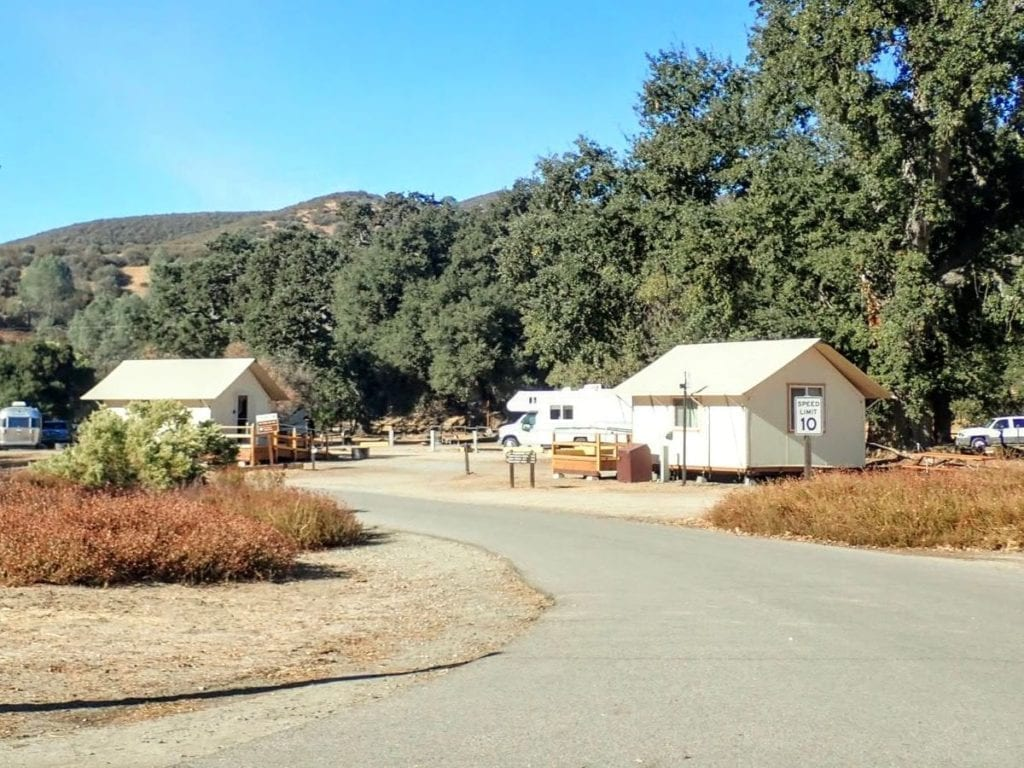 White tent cabins at campground