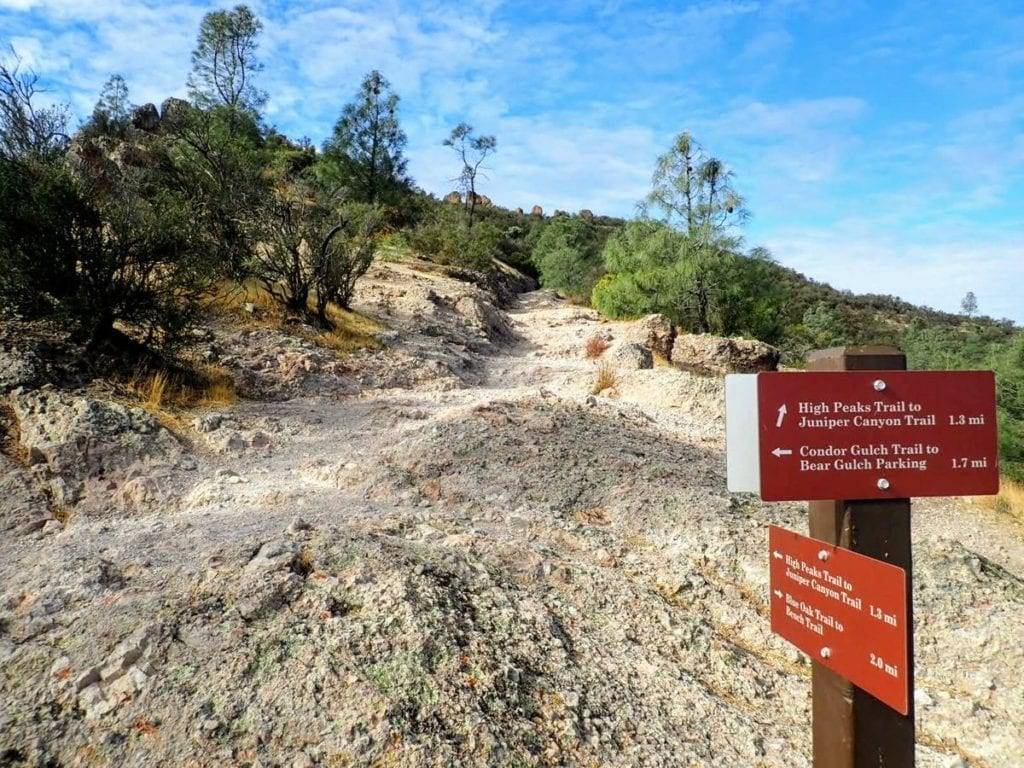 Signs mark the trail junction to High Peaks Trail in Pinnacles National Park