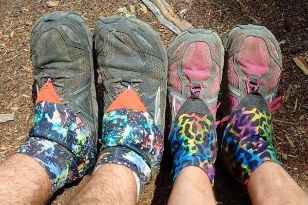 Two pairs of hikers' feet in Altra Lone Peaks and Dirty Girl gaiters