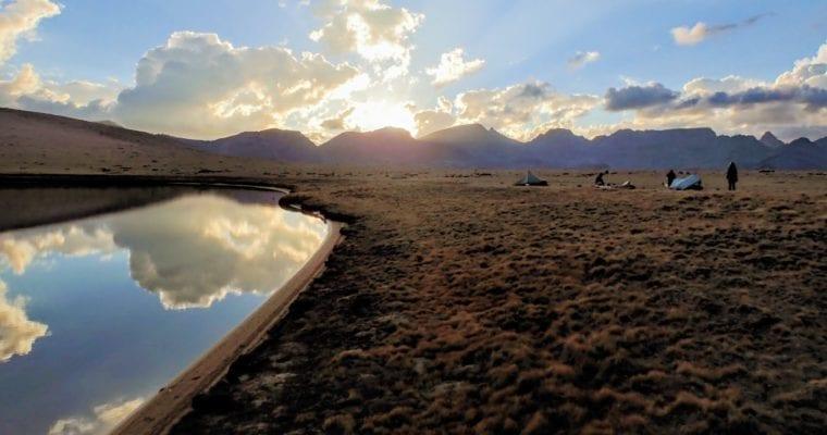 Alpine plateau and lake at sunset