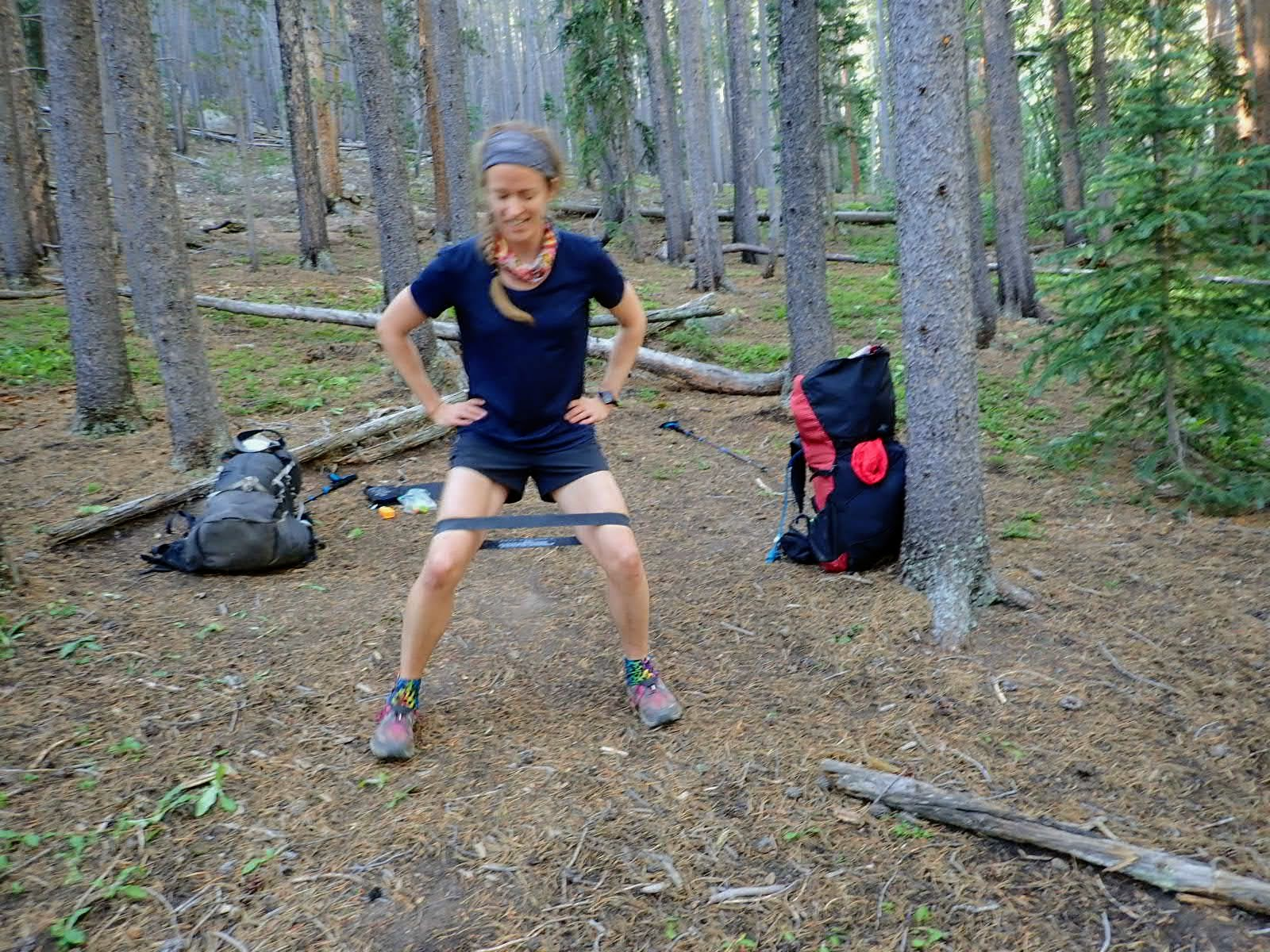 Hiker does side steps with mini resistance band