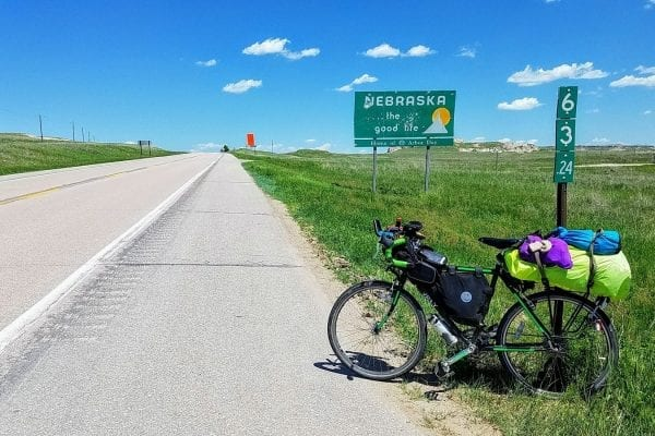 Bicycle parked at Nebraska state line on cross-US bicycle tour