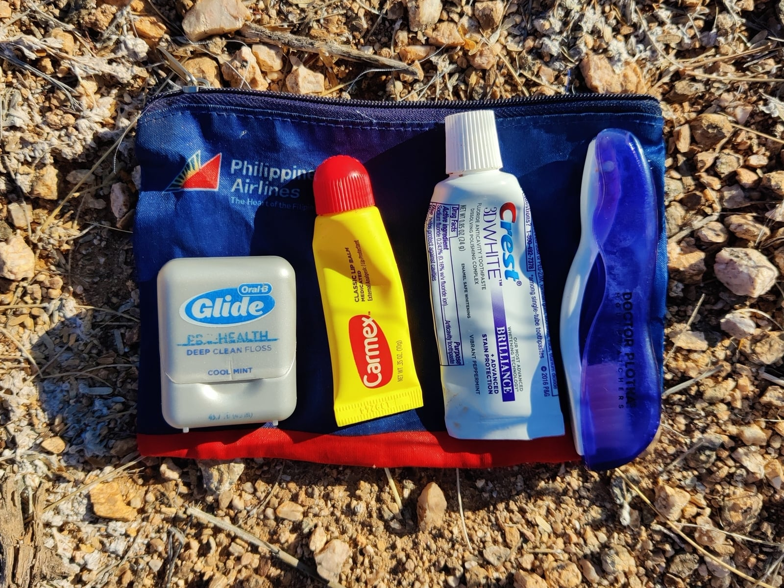 Travel size toothbrush, paste, floss, and lip balm for backpacking