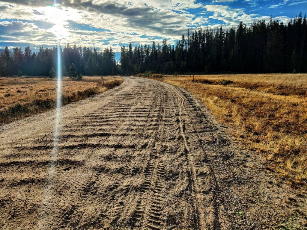 Badly washboarded gravel road shows difficulties of bikepacking the Smoke n Fire event
